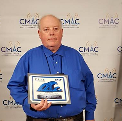 William Elliott, smiling holds the certificate recognizing 'Blindside Fresno' as a finalist and runner up in the WAVE awards 2017.
