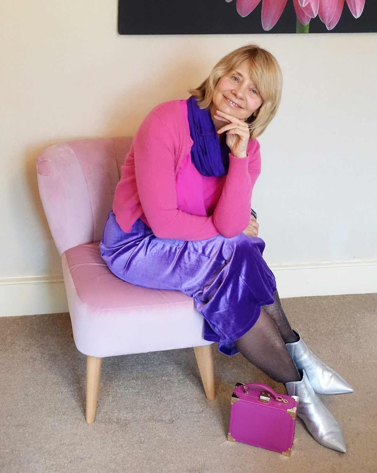 A glamorous velvet skirt in violet with a bright fuchsia top and purple