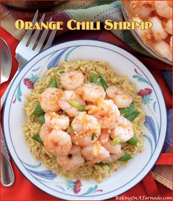 Orange Chili Shrimp, large shrimp are pan sauteed, add in a sweet and spicy sauce and dinner is ready in 20 minutes.  | Recipe developed by www.BakingInATornado.com | #recipe #dinner
