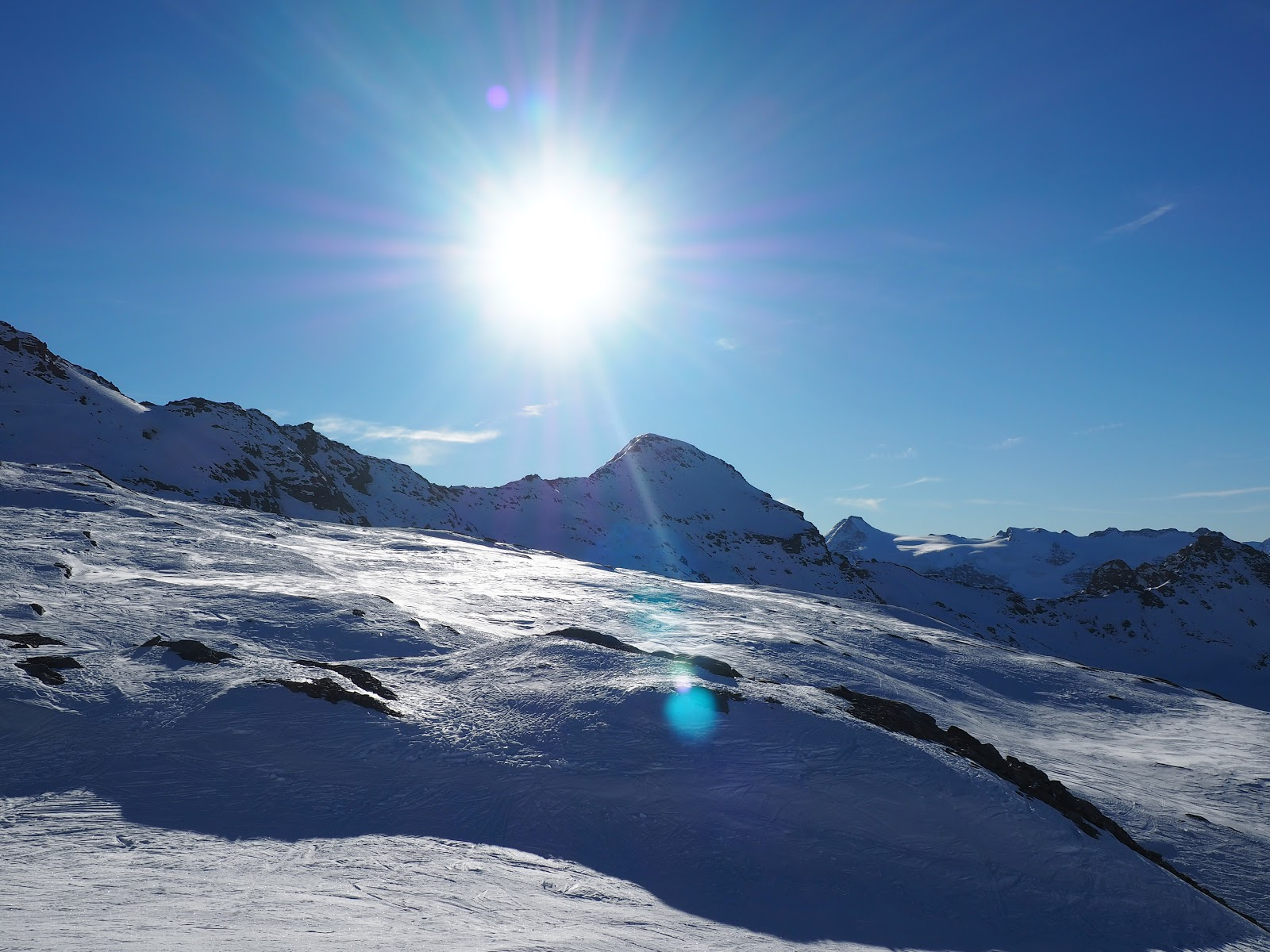 top of a snow topped mountain in Val d'isere, France