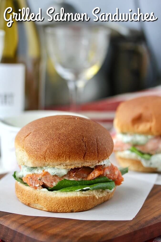 Grilled Salmon Sandwiches with Basil Dill Sauce on a toasted bun