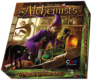 The Alchemists box, showing the cover art of a man in wizard's robes holding a frog in one hand as he adds drops of a strange liquid to a brew from which small hands can be seen reaching, as an apprentice climbs out a window in the background to escape the insanity of his master.