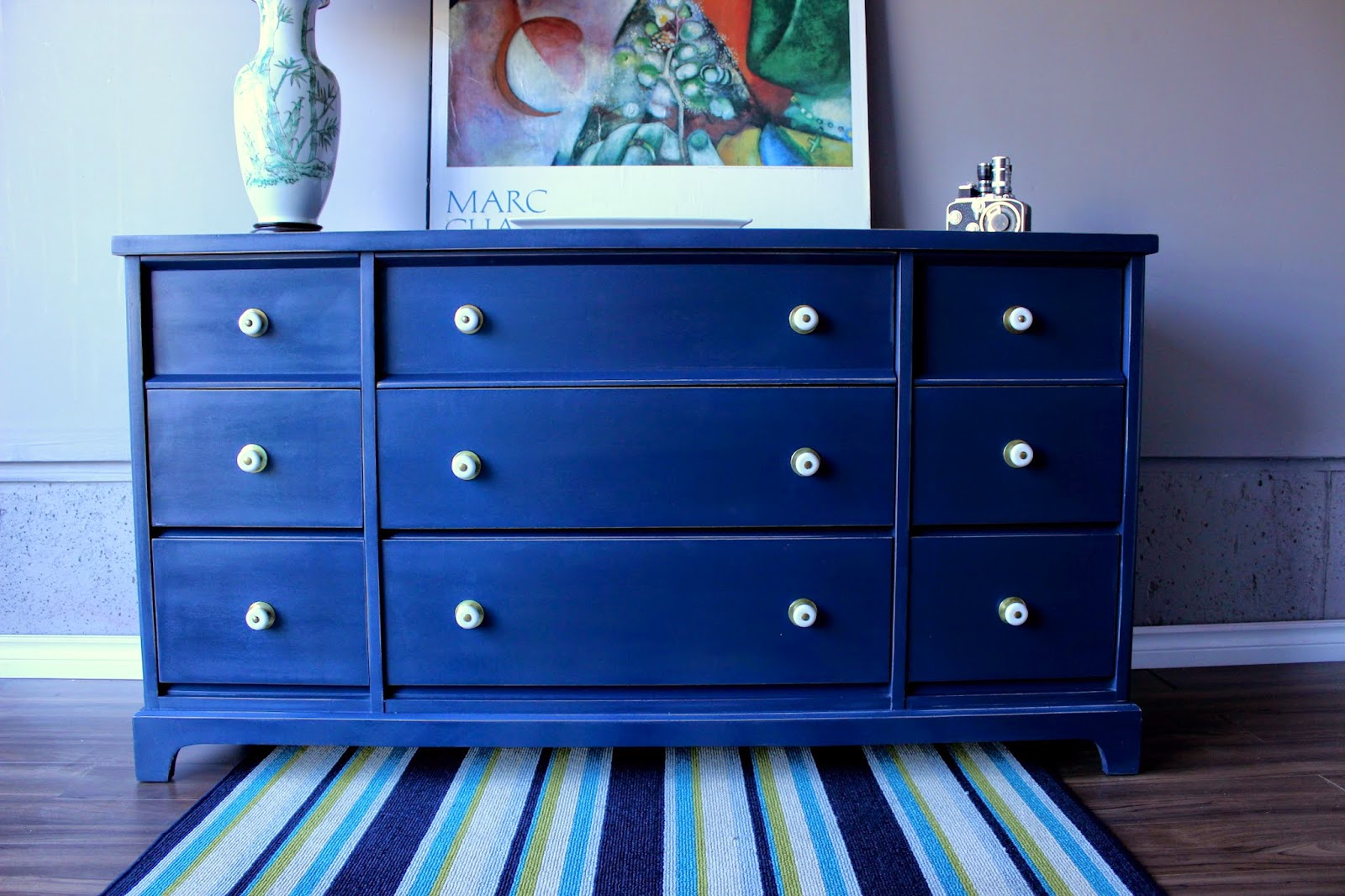 http://re-tiqued.blogspot.ca/2014/12/navy-dresser-with-added-hardware.html