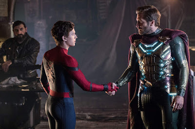 Spider-Man, played by Tom Holland, and Quentin Beck, also known as Mysterio, played by Jake Gyllenhaal, shake hands when they meet for the first time in Spider-Man: Far From Home