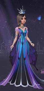 Princess Helen in an iridescent blue and purple butterfly gown with oversized wings and a grand silver crown