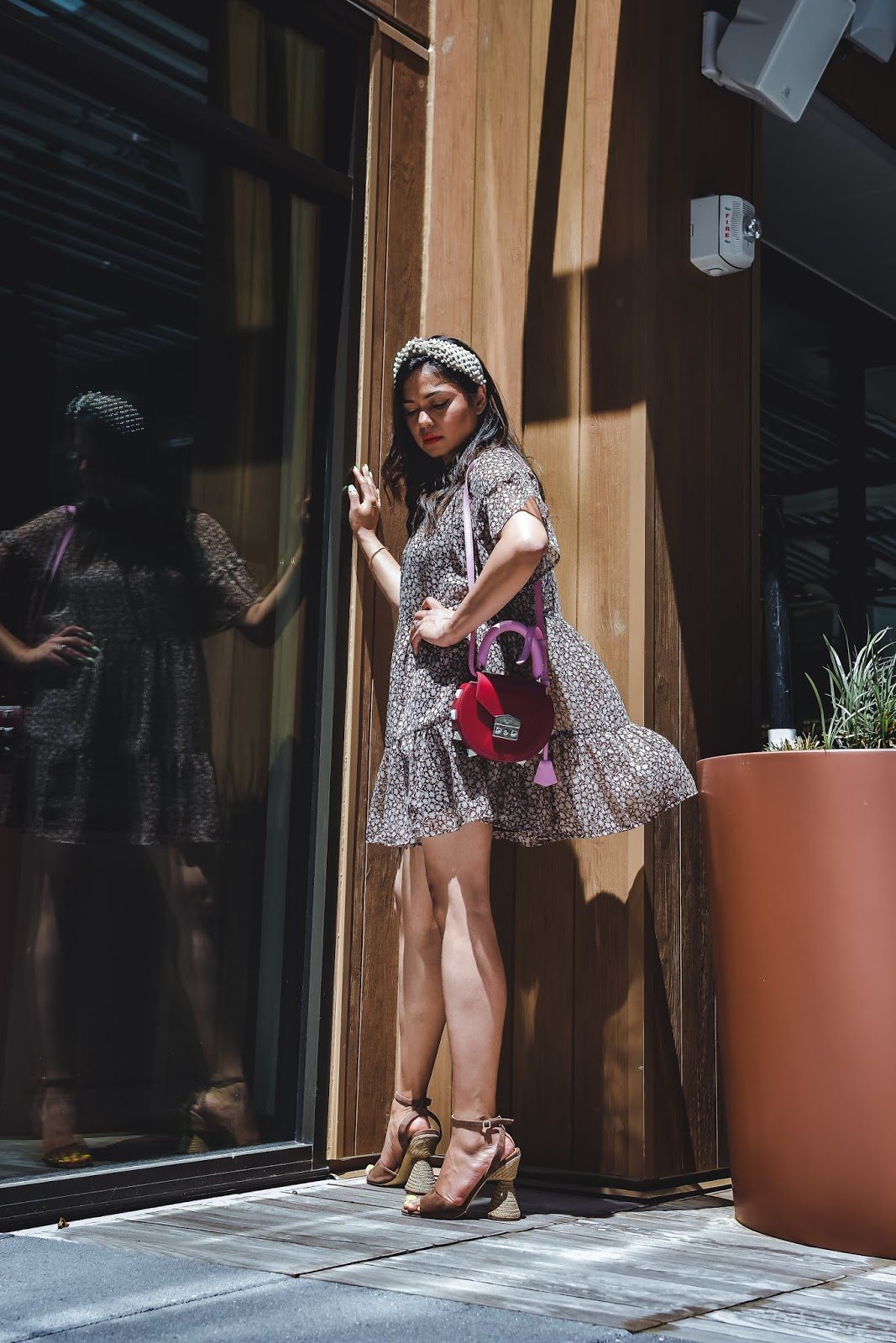 summer floral dress, cone heel sandals, neutral in summer, mini dress with heels, wedding outfit, lele sadoughi headband, pink purse, fashion, style, myriad musings, saumya shiohare