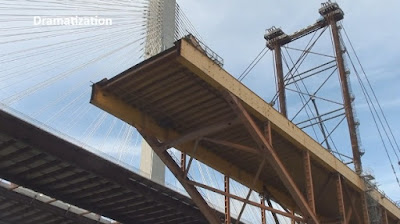 View of old bridge being dismantled beside new bridge from below.
