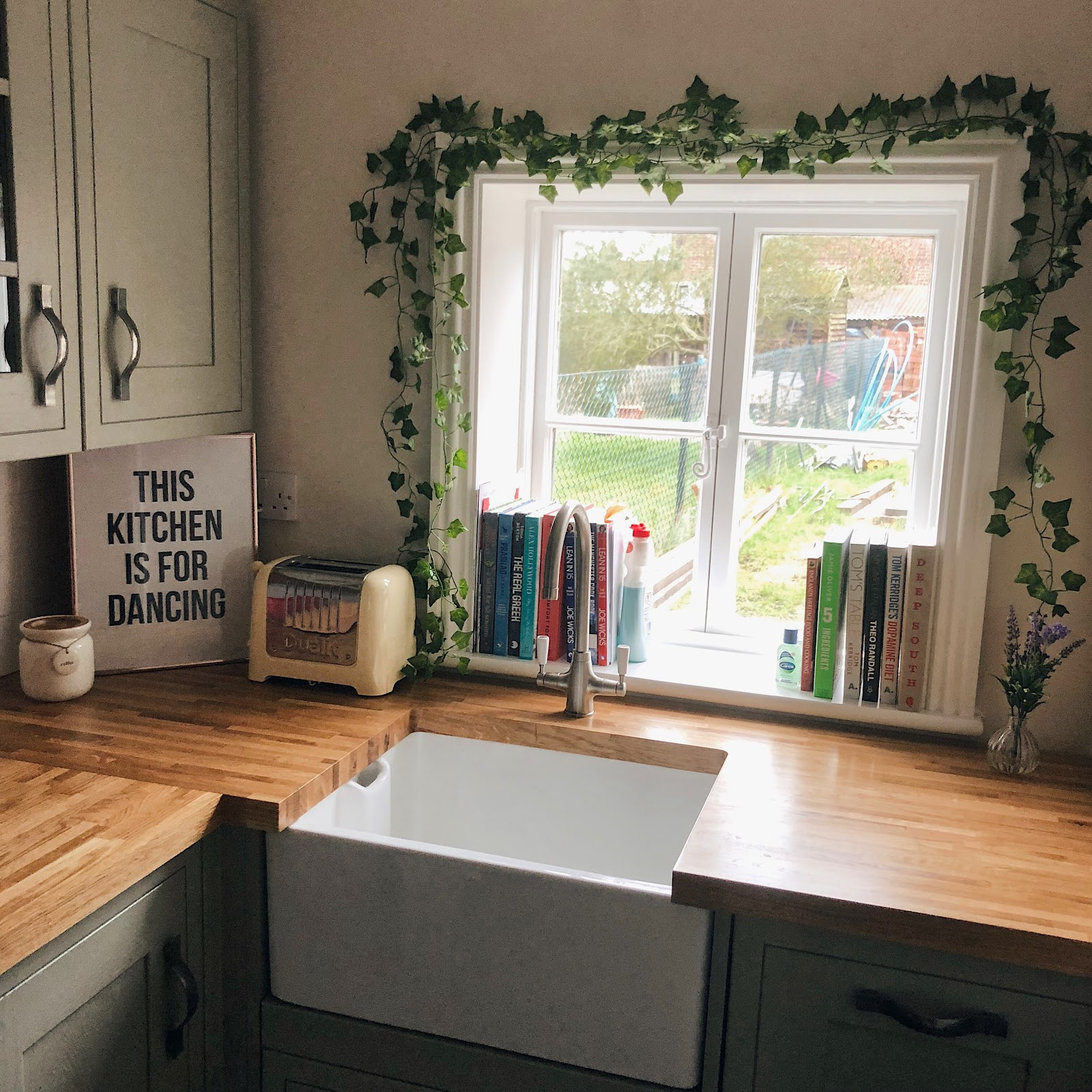 sage green kitchen with wood worktop