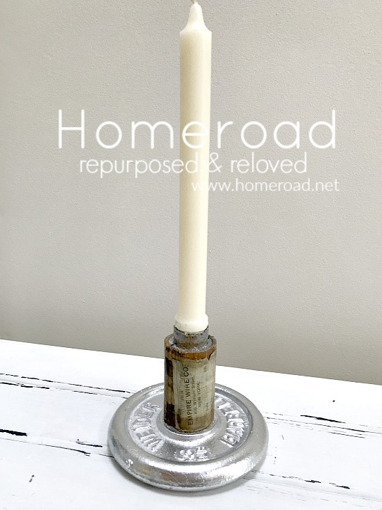 DIY industrial candle holder from an antique spool and weight