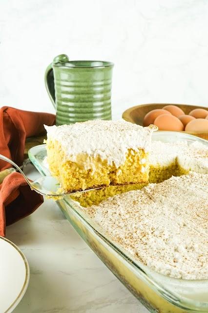 slice of cake on a spatula over a cake pan
