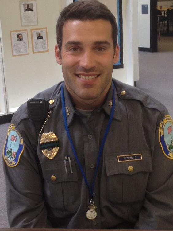 cute-uniformed-boyish-male-officer-smiling
