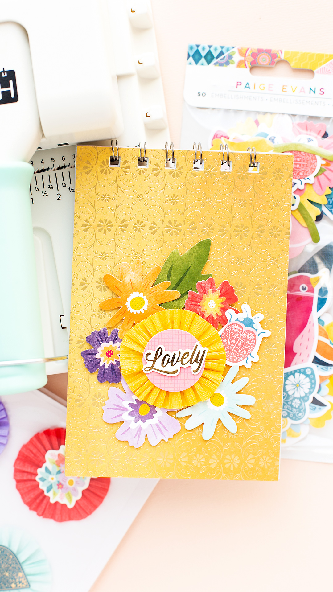 Title cover with yellow scrapbooking paper and flowers by Paige Evans Mojosanti Sandra Dietrich