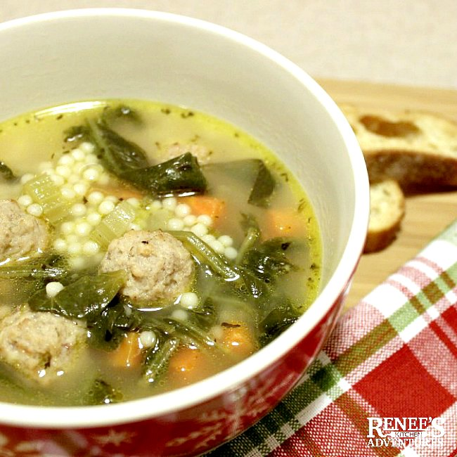 Easy Italian Wedding Soup by Renee's Kitchen Adventures in a red and white bowl