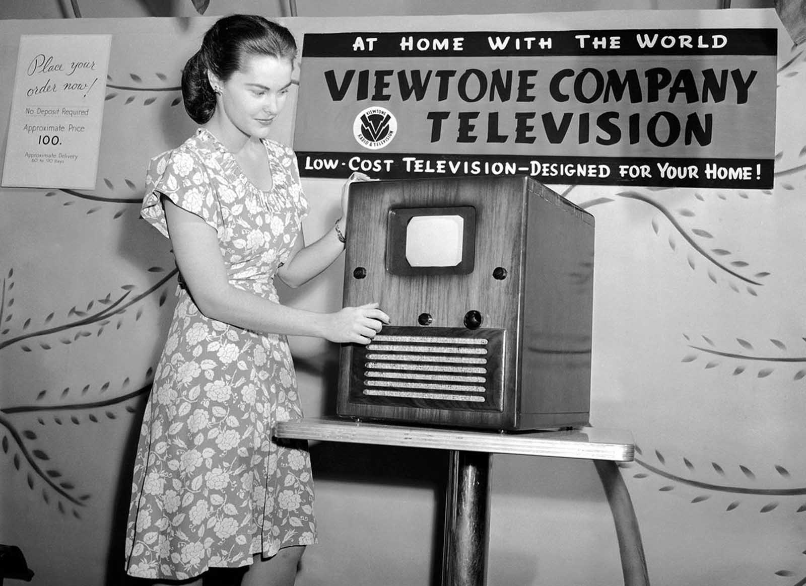 This television set, retailing for $100, is reportedly the first moderately priced receiver manufactured in quantity. Rose Clare Leonard watches the screen, which reproduces a 5x7 image, as she tunes in at the first public post-war showing at a New York department store, on August 24, 1945. Although television was invented prior to World War II, the war prevented mass production. Soon after the war, sales and production picked up, and by 1948, regular commercial network programming had begun.