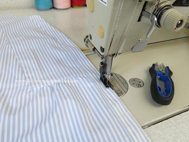 blusa con botonera pespunteada