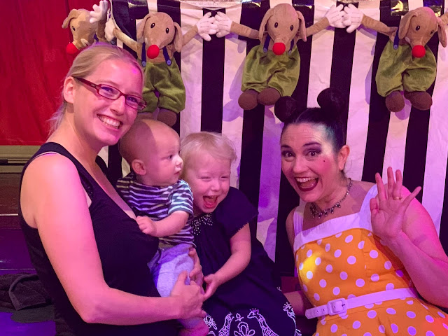 A mum, baby and 3 year old posing with Monski Mouse after going to the Baby Disco Dance Hall to Review it