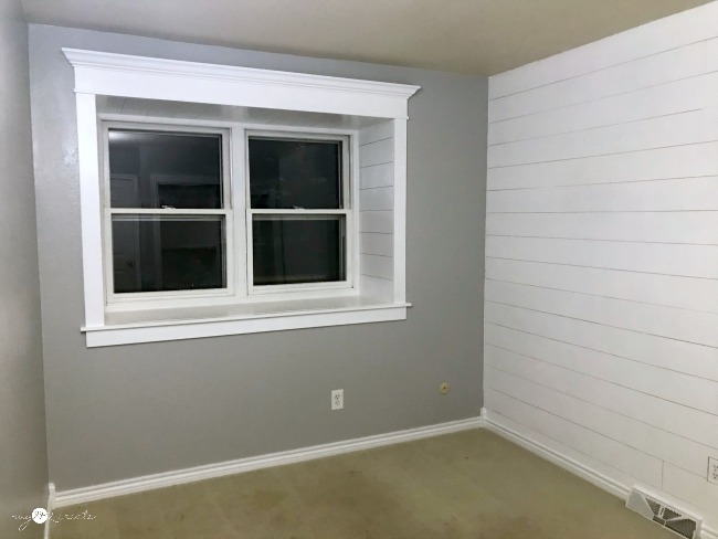 Trimmed out window and plank wall