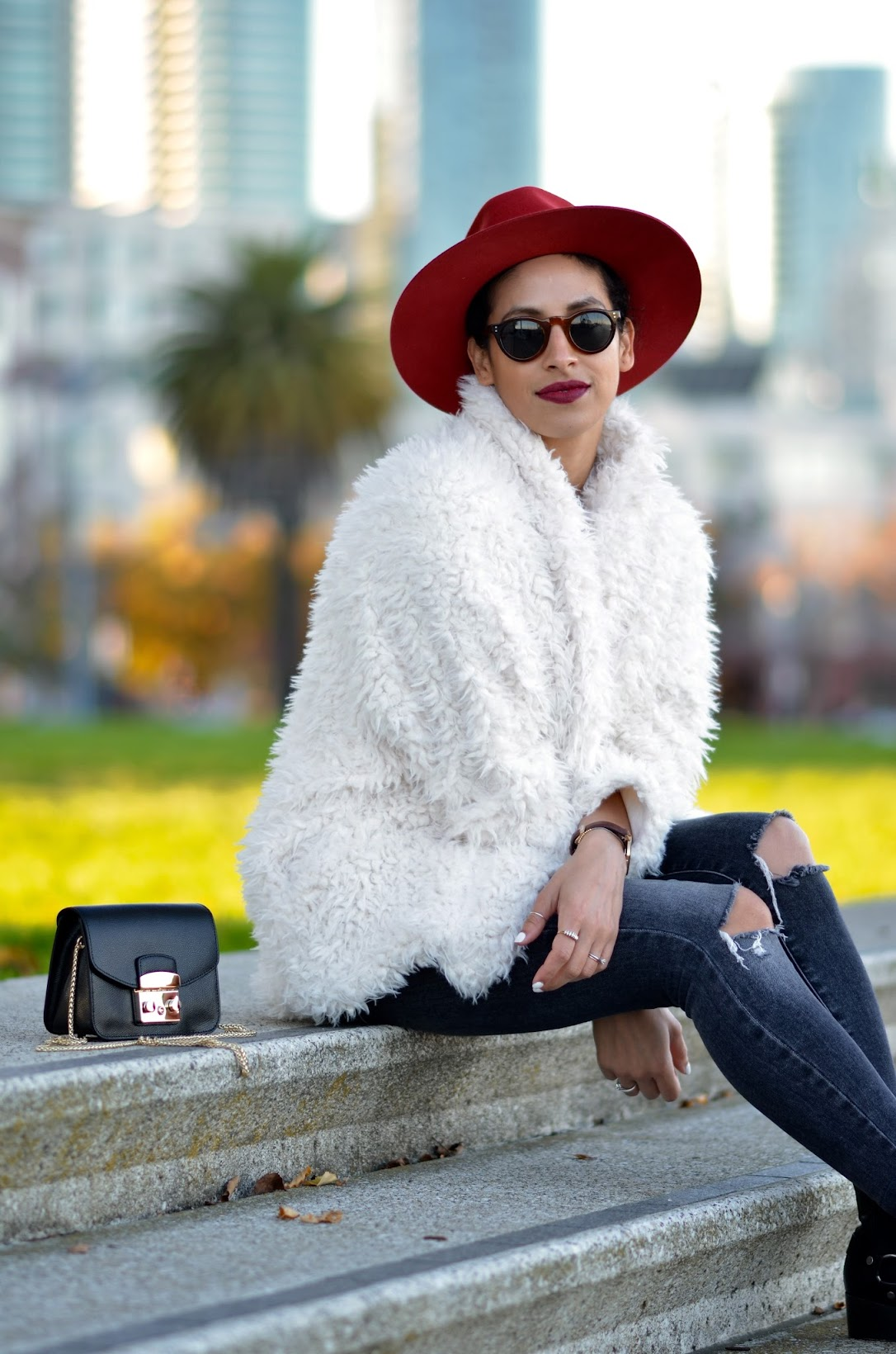 Frye moto harness boots, Red Goorin Bros fedora, J Brand denim, white fuzzy faux fur coat, white faux fur coat, burgundy lipstick, chic rainy day style, chic winter style