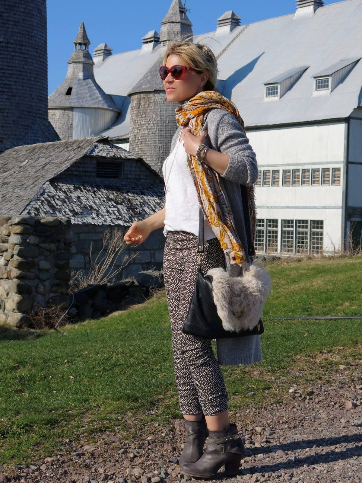 styling dotted skinnies with a slouchy tee, long cardigan, booties, and floral scarf