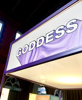 A rectanguar box with Goddess in bold white font with a light lilac background on a bright background.