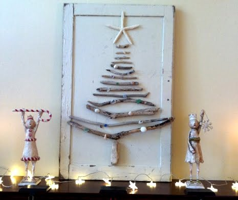 driftwood Christmas tree mounted on cabinet door