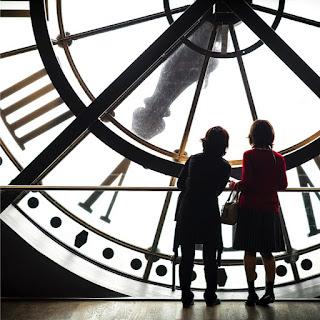 Children by a clock waiting