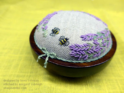 The top of the Lorna Bateman Lavender and Bees pincushion from the front
