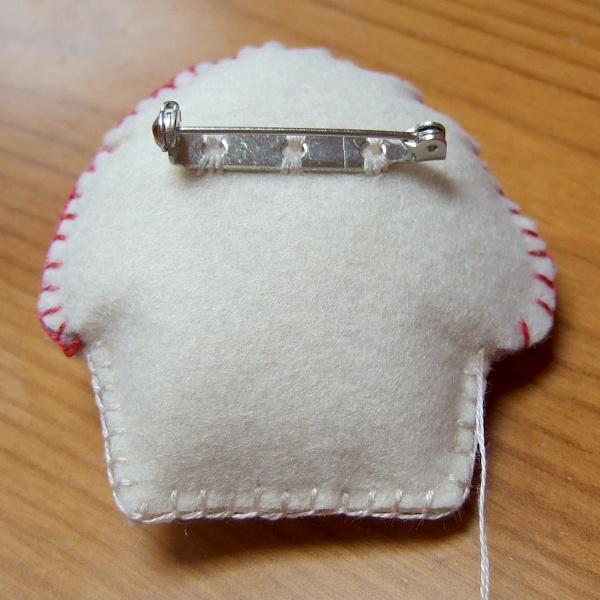 The reverse side of the homemade felt brooch pin design