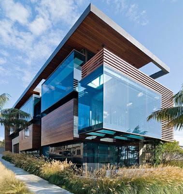 modern house facade designs of glass and wood panels