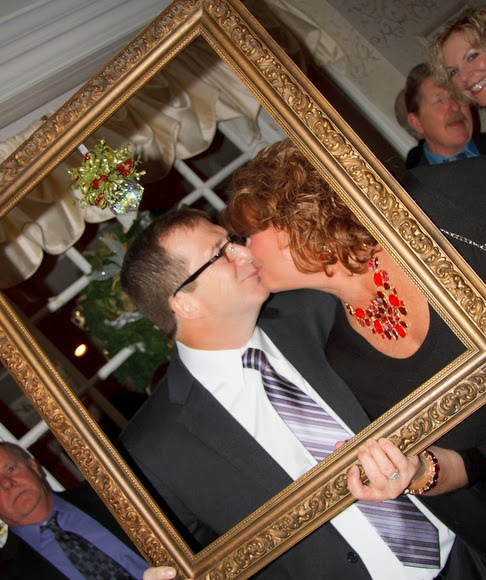 Family friends share a kiss under the mistletoe