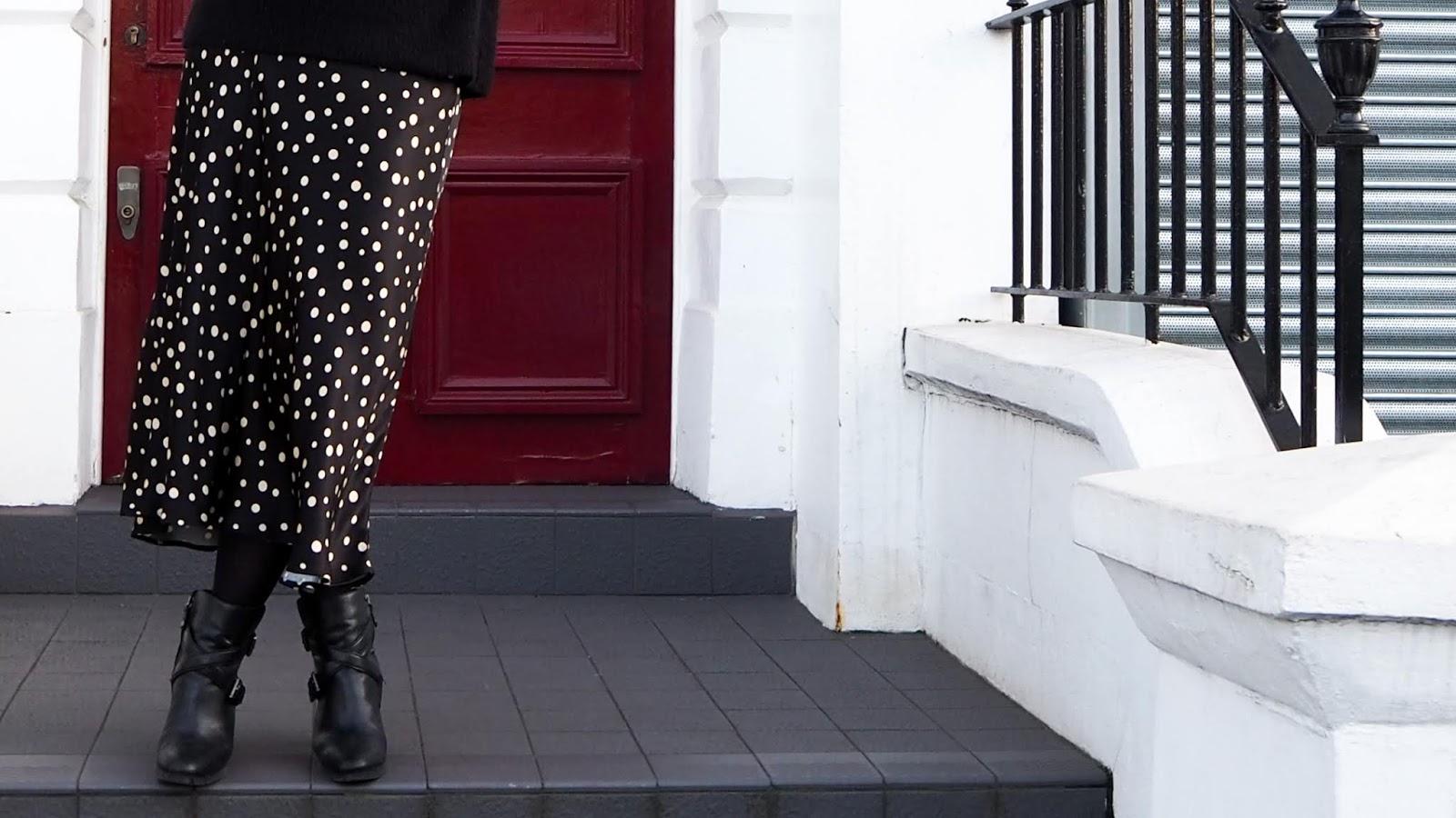 Satin bias cut polka dot skirt close-up