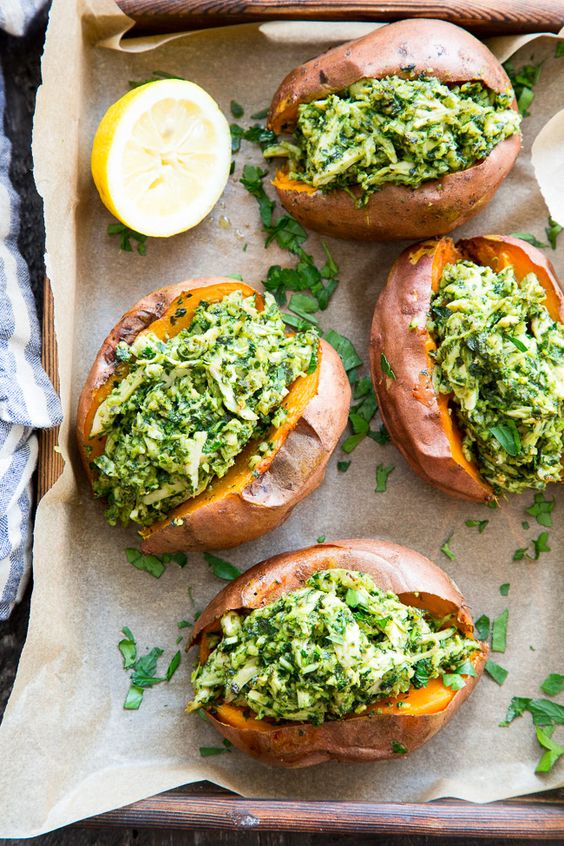 These chicken pesto stuffed sweet potatoes are seriously tasty, filling and easy to make! A paleo and Whole30 compliant pesto is mixed with shredded chicken and tops perfectly baked sweet potatoes