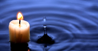 A candle in water Click to Enlarge.