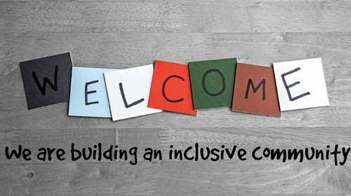 Letter to spell welcome on colorful tiles and the words we are building an inclusive community; Removing the Stumbling Block