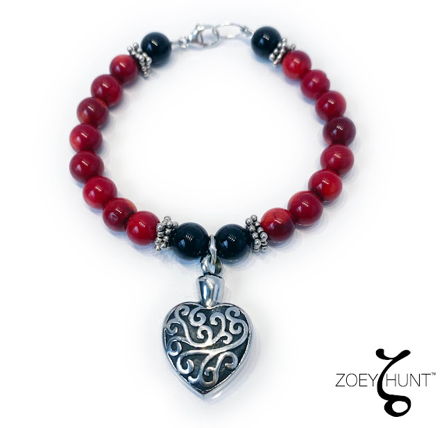 Red & Black Goth Bracelet with a Heart Charm that you can put ashes inside.