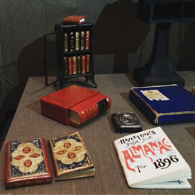 Selection of miniature books on display.