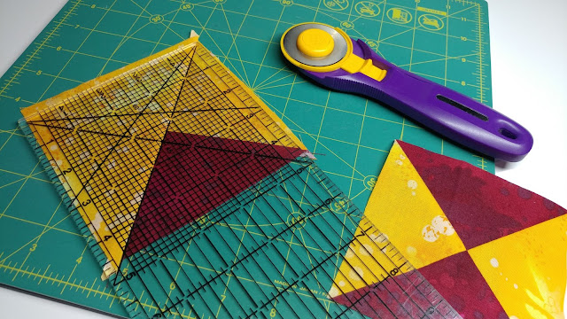 Trimming quarter square triangles with a rectangle ruler