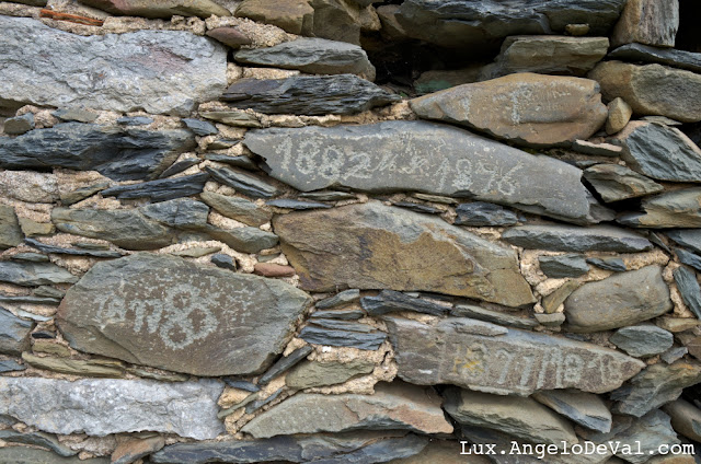 http://fineartamerica.com/featured/old-schist-wall-with-several-dates-from-19th-century-portugal-angelo-deval.html