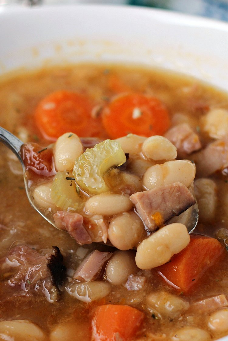 Ham and Bean soup on spoon in bowl