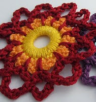 http://www.mycrochetprojects.com/blog-content/uploads/2012/07/The-second-paradise-flower.pdf