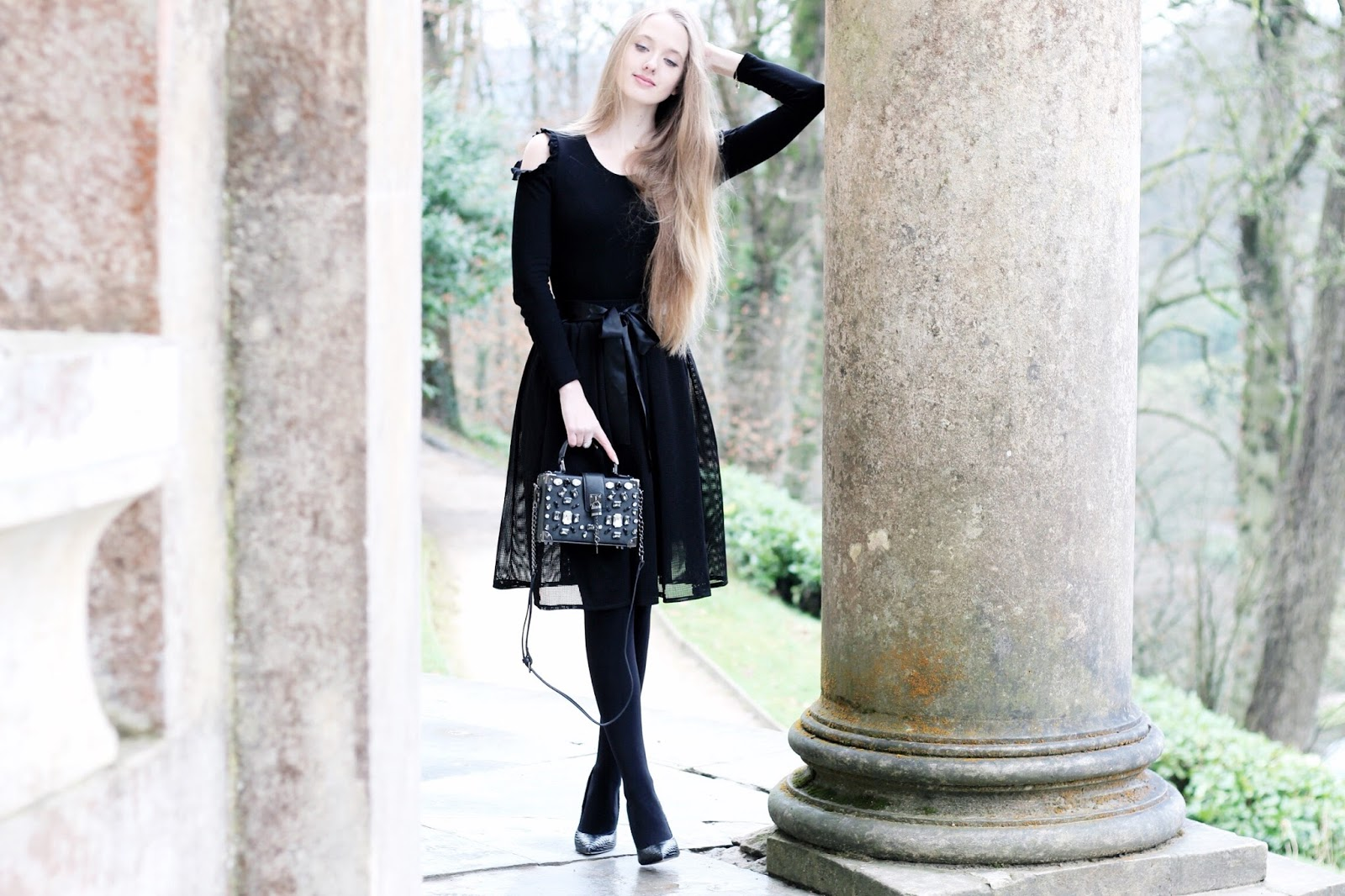 All black styling a statement bag in winter