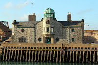 Old Customs Watch House with green copper observation dome (cupola, belvedere) built 1909-1911 by architect, Arthur Beresford Pite. Listed Building. Inner Harbour; Tidal Harbour, Dover Marina (right). View: North Pier (hoverport). Kent.