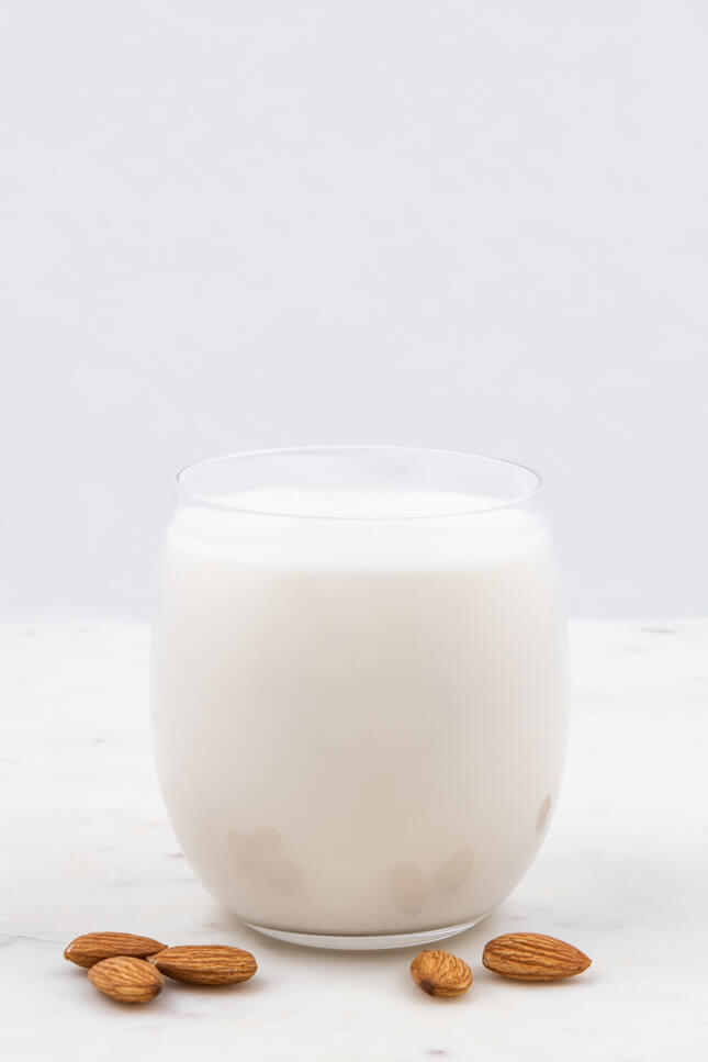 Profile shot of a glass of almond milk