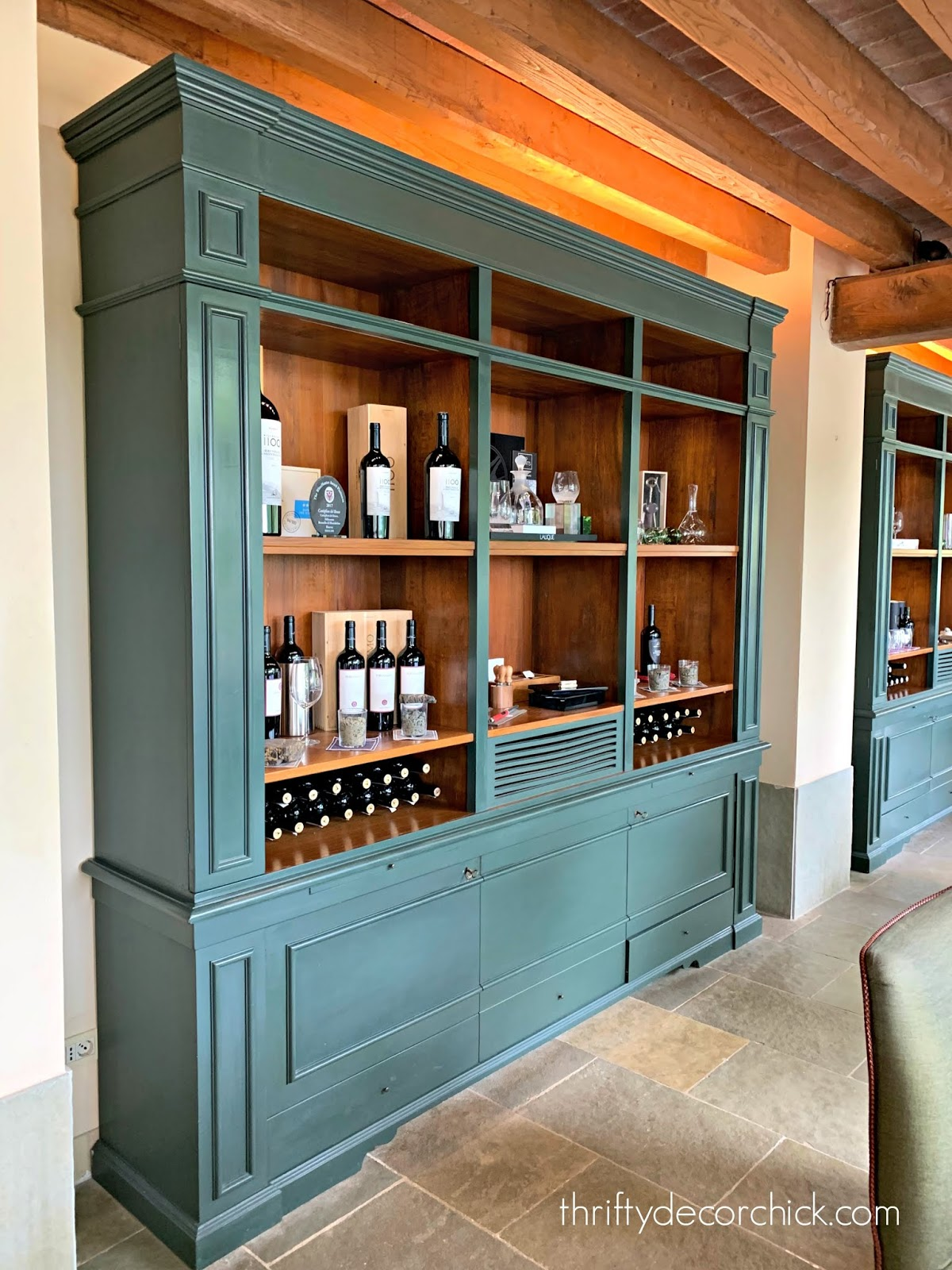 Dark green cabinetry with wood interior
