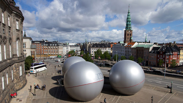 Three silver spheres from the air