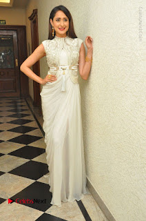 Actress Pragya Jaiswal Stills in Beautiful White Dress at turodu Audio Launch  0051.JPG