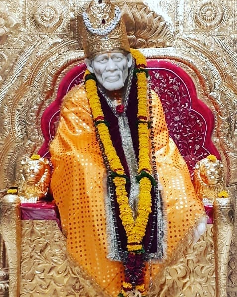 Golden Mukut wear sai baba  images darbar