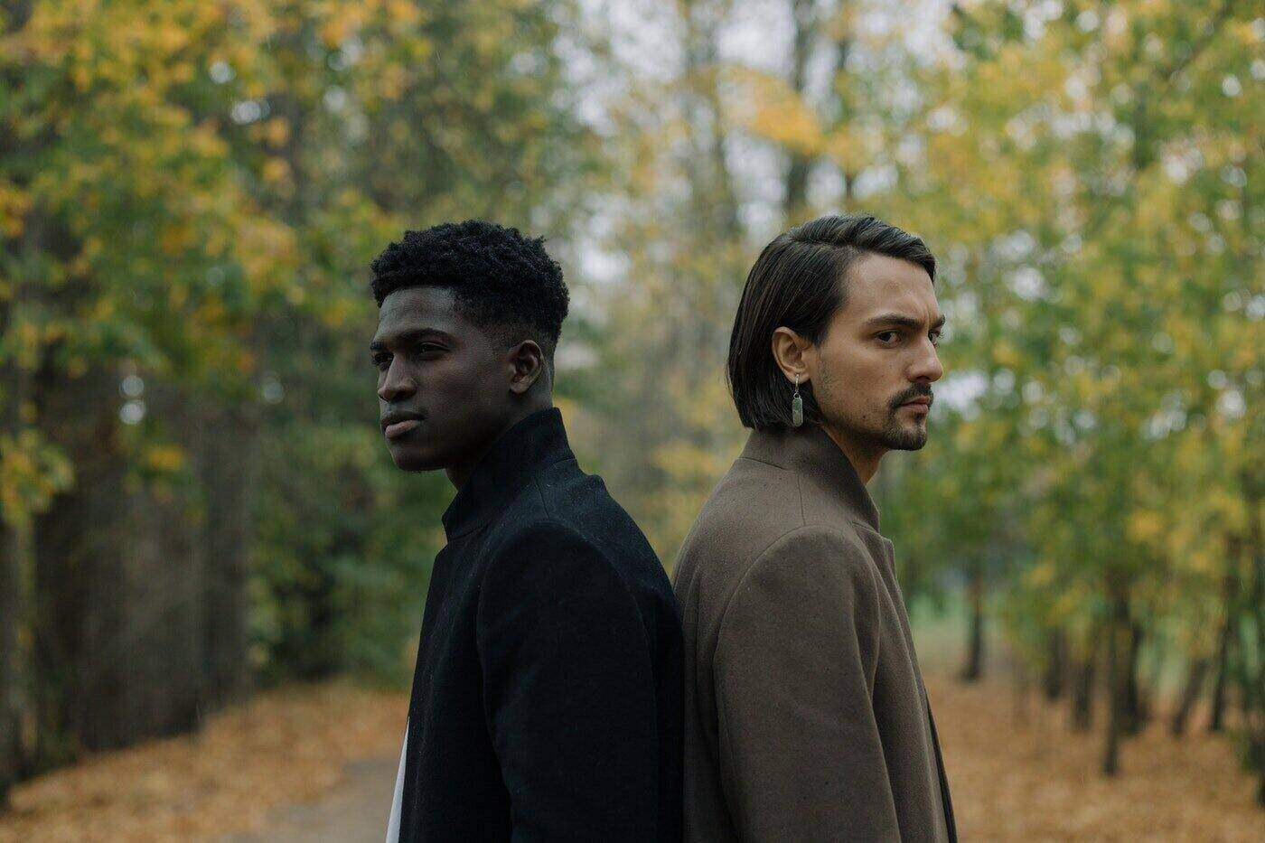two men standing back to back under trees - how to make ethical fashion part of your wardrobe