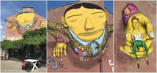 Mural with Grandpa in hand by artist Os Gemeos in Vilnius in Lithuania