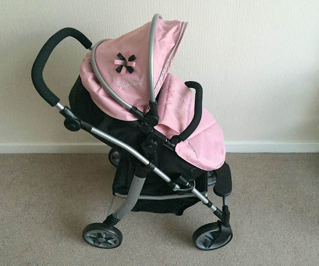 side view of Silver Cross Pioneer doll pushchair